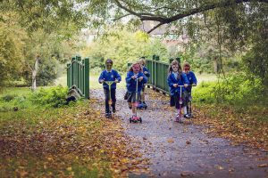 children-scooting-park
